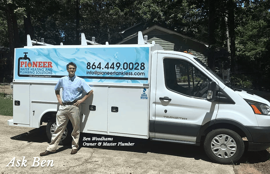 Professional plumber Benjamin Woodhams standing with his plumbing work truck from which he does new plumbing and water heater installations and repairs